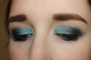 The closed eye shot for my teal smokey eye. I used Maybelline Color Tattoo in Tenacious Teal as a base and layered blues and blacks to create this look.