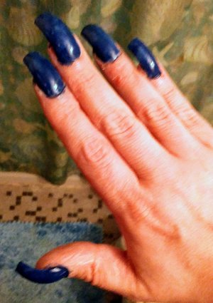 Blue marbled design on hawk curved acrylic nails.