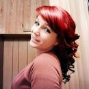 Red/black hair. Layered curls.