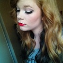Winged eye with red lip