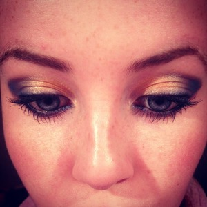 It's my brother in laws birthday on Tuesday and I wanted a look which would look nice for my new dress. The dress is a deep sea blue and I've accessorised it with lots of chunky gold bling and gold shoes. However, I needed to practise what makeup I would do. Gold and blue? I am quite proud of my first attempt for a look to go with my outfit. I hope my fiancé finds it really sexy!