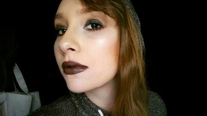 Dark green on the lid with bronze on the crease.  Smokey eye with dark lip