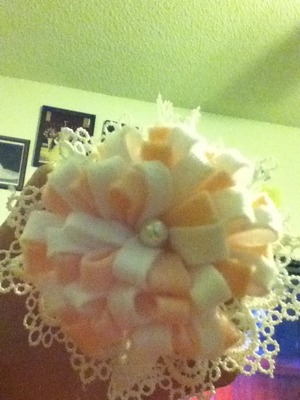 My mom made this super cute bow but still has to be on a clip or headband! :)
