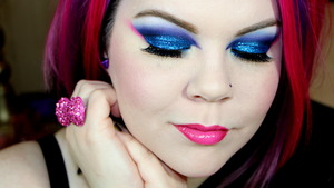 A Shot of the makeup with my eyes down. This Makeup is inspired by the Princess Aurora from the movie Sleeping Beauty. The Art style of the movie is fantastic so I wanted to create a lovely angular and textured look. The good Fairies fight over making her dress Pink or Blue, so I used that color palette and ran with it making the colors punchy and bold to suit my taste.
