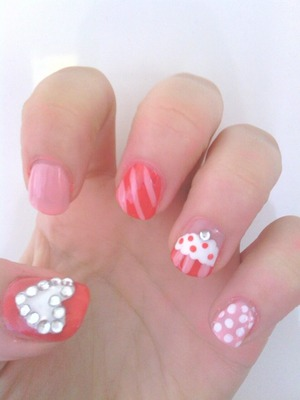 A mixture of different nail art designs, rhinestone heart, stripes, polka dot and cupcake