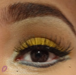 """A bright yellow look using """"Buttercupcake"""" by Sugarpill. More pics: http://www.abeautywithbrains.com/2013/04/eotd-bright-yellow-eye-look.html#comment-form"""