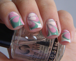 http://thepolishwell.blogspot.com/2013/01/nail-ideas-vintage-retro-water-marble.html