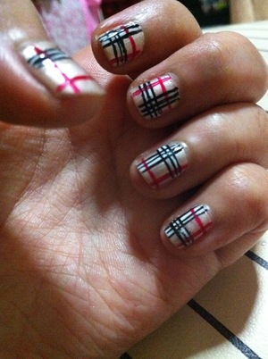 For the base i used sheer gold nail polish followed by red,white and black with striping brush