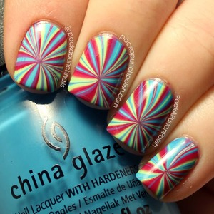 A star burst water marble design!  Polishes Used: China Glaze: Traffic Jam Spontaneous Sunday Funday Entourage  The white base polish is Sally Hansen Xtreme Wear White On.  Tutorial: http://youtu.be/Zfwke56qjBY  Full Blog Post: http://www.packapunchpolish.com/2013/03/star-burst-water-marble-nail-art.html