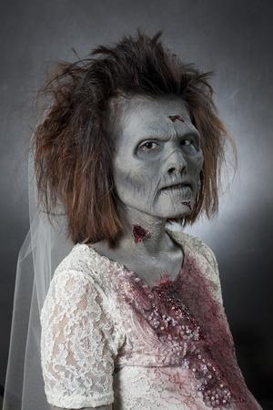 My pregnant bride zombie with gelatin facial prosthetics.