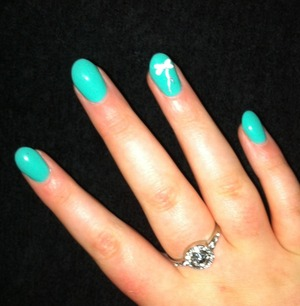 Turquoise acrylics with bow 🎀 xx