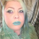 Colorful Cat Eye And Turquoise Lip