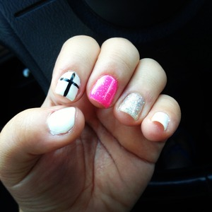 Gel nail polish with glitter and a cross