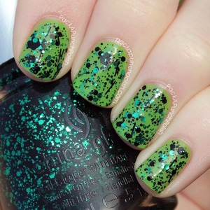 This is Graffiti Glitter by China Glaze. It's part of the Glitz Bitz 'N Pieces Collection. It is emerald green and black glitter in a clear base.  I have one coat of Graffiti Glitter over China Glaze Gaga For Green with a coat of Out The Door top coat.  Full Blog Post: http://www.packapunchpolish.com/2013/01/china-glaze-graffiti-glitter-swatches.html