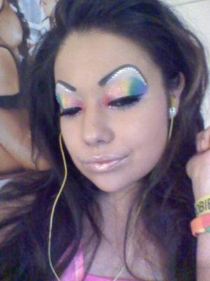 Getting ready for pride fest. Rainbow eyes with rhinestones