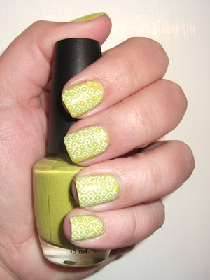 OPI Did It On Em with a fun geometric pattern stamped on them in white :) http://polishmeplease.wordpress.com