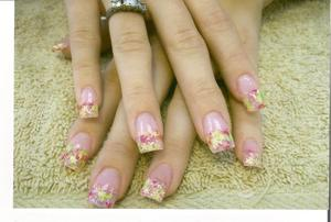 acrylic nails with confetti tips added in the acrylic.