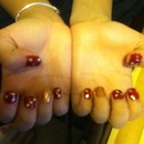 Red and Gold nails with Gold stars