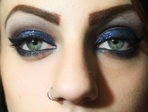 A blue and brown smokey, glittery eye.