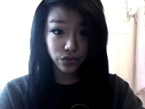 black hair black sweatshirt with a snowy look:)