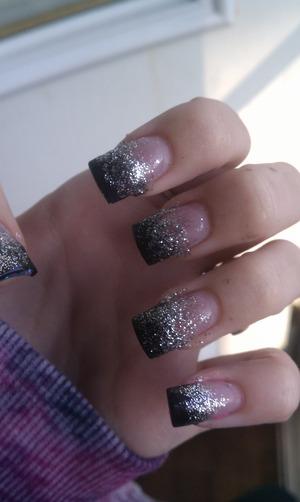 sparkles that fade onto black acrylic