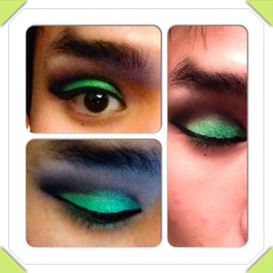 A funky black smoky eye with a foiled emerald lid.