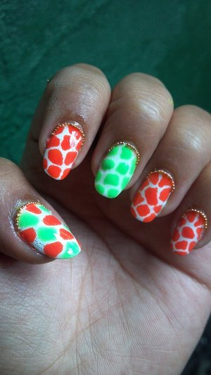 Did a coral and mint green giraffe print with nail caviar reverse french... and then air bubbles came and effed it up... Wah.