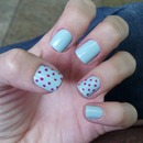 Pastel blue with pink dots.