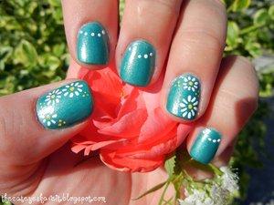 http://thecateyeshaveit.blogspot.com/2012/06/zoya-zuza-and-dainty-daisies.html