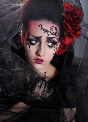 "Makeup by Blanche Macdonald Makeup graduate Kiki Xiang. She won 1st place with this look for the 2012 Modern Basic ABA Makeup Competition! ""I was inspired by both Tim Burton's gothic nature in his films as well as the roses on my model's dress. I translated Tim Burton's quirky and iconic tree illustration along the cheek and onto the forehead freehand using Black Chroma Color. When I was in China, I took calligraphy courses to help with penmanship. I used the same black on the eyes and Pink Chroma Color for the eyelid and lip base."""