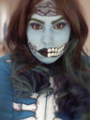 I used face paint, eye shadow, and eye liner to do this cartoon zombie makeup. Link to a quick video that shows more details https://www.youtube.com/watch?v=B0-n18qYoJE