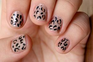 Freehand leopard design on short nails.  http://iloveprettycolours.blogspot.com/2011/08/mannequin-hands-vs-leopard-print.html