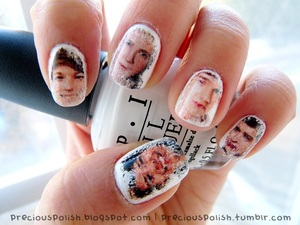 One Direction nails using a newspaper nails technique.