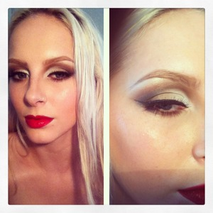 Neutral but dramatic eyes with a bold red lip.
