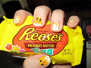 paint nail yellow, let dry, pain black dots, then pain white inside for eyes, take orange and make triangle. For egg shell use white shatter