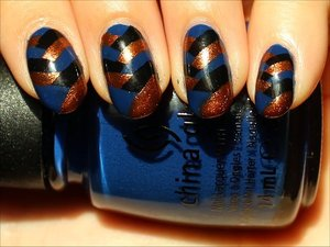 See more swatches & my tutorial here: http://www.swatchandlearn.com/nail-art-tutorial-fishtail-braid-nails/  Used China Glaze Liquid Leather (black), China Glaze Harvest Moon (bronze) & China Glaze Man Hunt (blue)