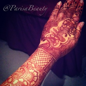 Bridal Henna Stain - I use 100% natural fresh henna paste. The henna paste is left to dry and then a lemon and sugar mixture is applied to keep it from crumbling. The stain develops into this dark shade over 48 hours after removing.