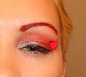 I used brick red for the shadow and brows with a white sparkle and a think liner and a small wing, finished it off with a hot pink heart. all shadow used was loose pigments and a damp brush