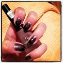 Matt nail polish with some silver and black dots,and with shiny black polish on my nail tips