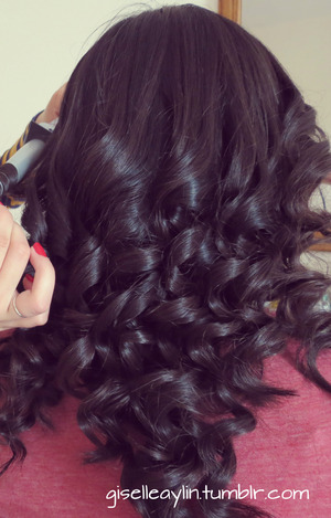 So, i love the curls that you can create with a clipless wand or curling iron. My friend was my model for this photo, his hair is so healthy. She has medium thick hair.  The curling iron that i was using is the Remington Textured Curling Wand Limited Edition.