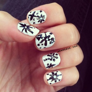 Black & White snowflake nails.. perfect for winter!! http://monrogue.com/black-white-winter-snowflake-nails/