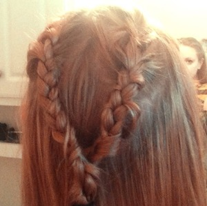 I was inspired to create these double French braids by the show Game of Thrones--the women on that series have such awesome braids!