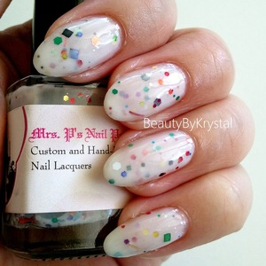 "Milky white base (opaque in two coats) with ""multi-colored, multi-sized and multi-shaped glitters"", there is so much fun packed into this bottle! http://www.beautybykrystal.com/2013/05/mrs-ps-nail-potions-its-my-party.html"