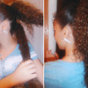 Curly pony tail.