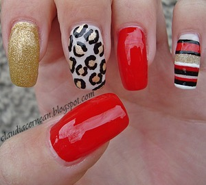 Tutorial on : http://claudiacernean.blogspot.ro/2013/04/unghii-rosii-red-nails.html