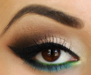 Mixture of smokey on top eyelid and subtle yellow and aqua green at bottom