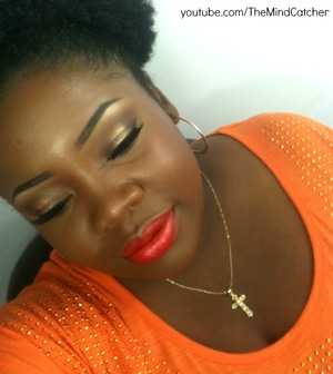 "Loving this drugstore lipstick from Black Opal Cosmetics. It's called ""Atomic Flame""."