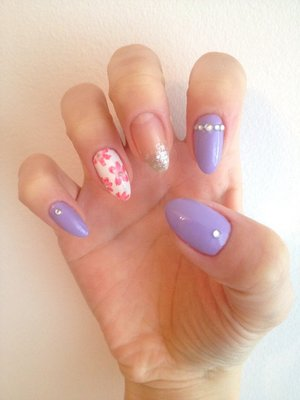 Natural stiletto nails with free hand painted flowers and glitter