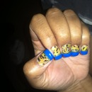 short and sweet cheeta nails with a gold strip to accent the royal blue...