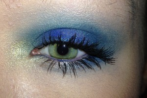 Urban Decay the Vice Palette Eye Makeup with Junkie, Chaos, Anonymous, Laced, and Blitz  On top of Maybelline Color Tattoo in Ready, Set, Green:  Chaos patted in the center of the lid and around the eye  Junkie in the crease and all the way around the eye  Laced above the crease to blend out  Anonymous to highlight  Blitz in the inner corner  Navy blue eyeliner on the top waterline and outer half of the bottom  Two coats of black mascara   http://pinterest.com/hellobbail/ http://hellobbail.blogspot.com/